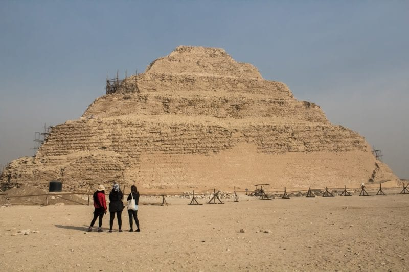 Sakkara with 3 girls gazing at the pyramid