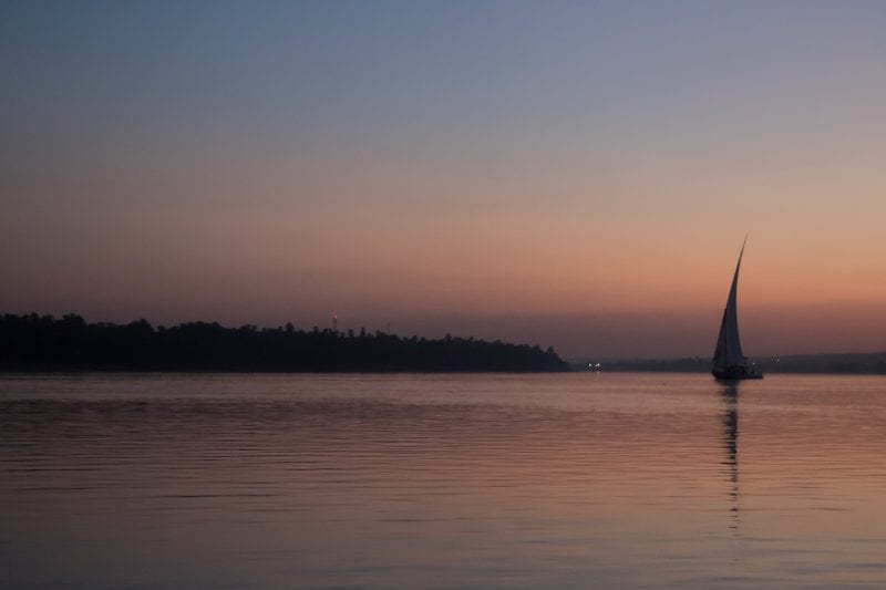 A felucca in the sunset on the river Nile.