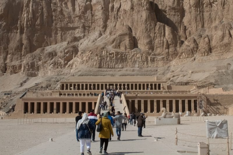 The entrance of Hatshepsut temple which is amongst a massive cliff of rocks
